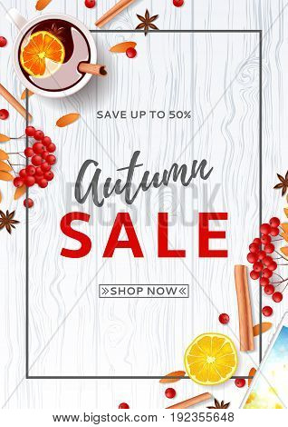 Beautiful flyer for autumn sale. Top view on composition with cup of mulled wine, rowan, cinnamon sticks on wooden texture. Vector illustration.