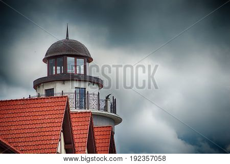 The architecture of the building in Kaliningrad beacon with a spire in the background roofs with red tiles