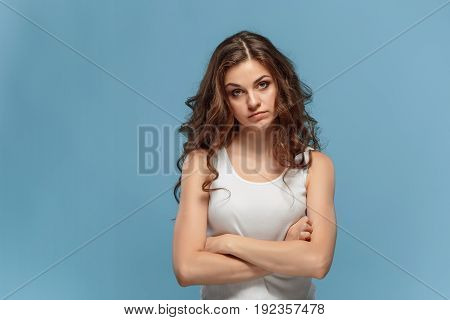 The portrait of disgusted woman on studio background