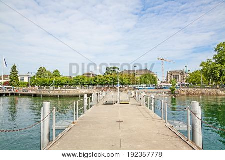 Zurich Switzerland - June 10 2017: Shipping pier at Burkliplatz where excursion ships starts for boat trips over Lake Zurich and river Limmat. View towards inner city of Zuerich.