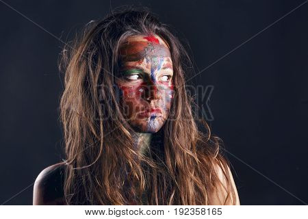 Girl With Her Face Painted With Her Own Hands.