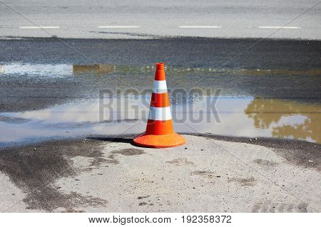 plastic signaling traffic cone encloses a place in the parking lot for trucks
