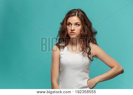 The portrait of disgusted stressed woman on studio background