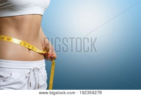 Young woman measuring waist thin sport beautiful