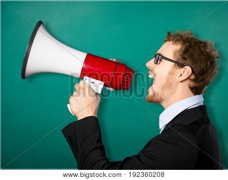Young man shouting megaphone green person people
