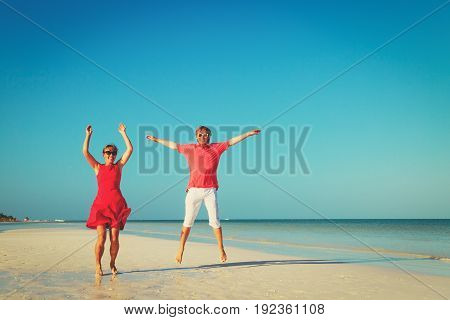 Happy young couple enjoy tropical beach vacation