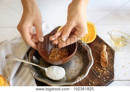 Woman preparing natural body scrub