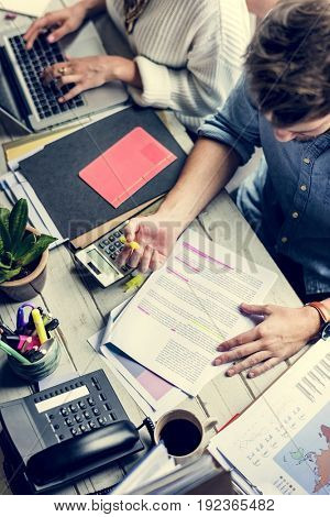 Man Checking Proofing Words on Article Journal