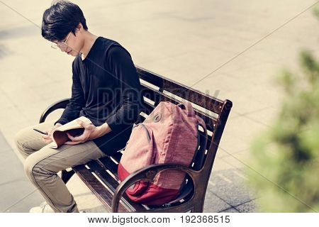 Asian Guy Making Notes Diary Notebook