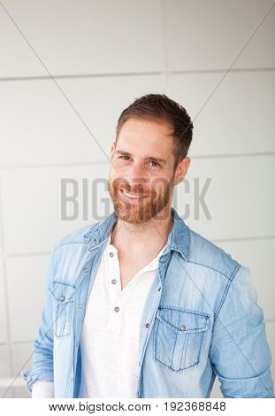 Portrait of a casual guy with denim shirt in the street