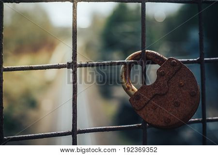 Old key lock on fence. The picture shows the ban on travel or movement by rail