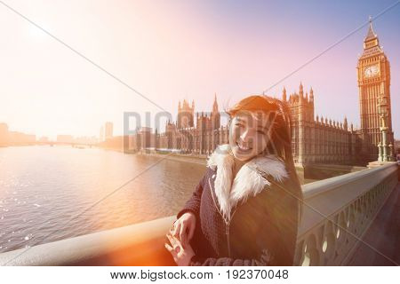 Portrait of happy female tourist visiting Big Ben at London; England; UK