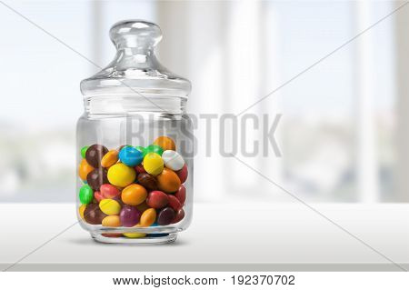 Color colorful glass jar candies isolated in white green