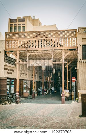 DUBAI, UAE - CIRCA AUGUST 2016:Traditional sand color architecture of Arabian city marketplace with almost no people and no entrance road sign