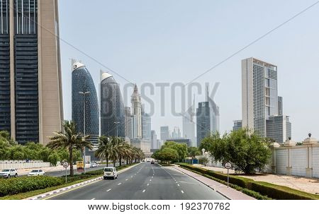 DUBAI, UAE - CIRCA AUGUST 2016:Palm Tree Lined Multi Lane Street Through Dubai Lined with Modern Architecture and High Rise Buildings on Sunny Day with Blue Sky, Dubai, United Arab Emirates