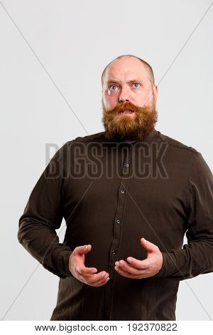 Surprised man with brown shirt