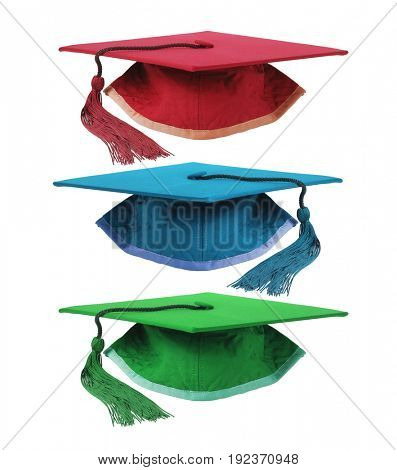 Three Colourful Graduation Mortar Boards on White Background