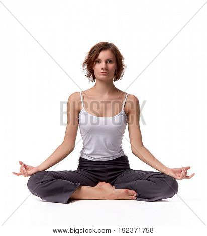The beautiful sports girl does exercises on a white background. Fitness.