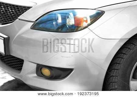 Damaged bumper of car involved in accident, closeup