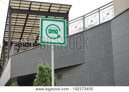 Road sign of electric vehicle charging station at car parking