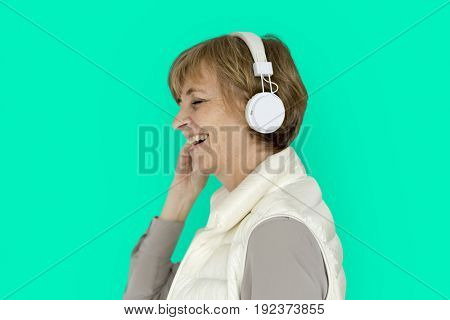 Senior Adult Woman Smiling Happiness Headphones Music Entertainment Studio Portrait