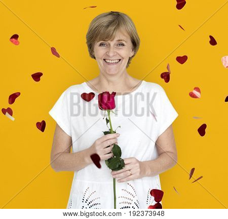 Senior Adult Woman Smiling Happiness Flower Studio Portrait