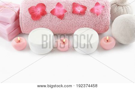 Composition with spa cosmetic, candles and hortensia flowers, isolated on white