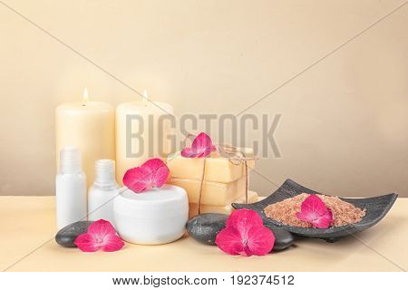 Beautiful composition of cosmetics with hortensia flowers on beige background
