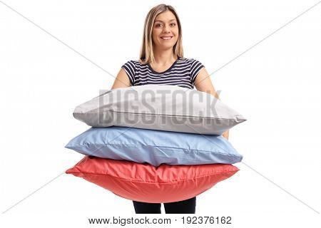 Young woman with pillows isolated on white background