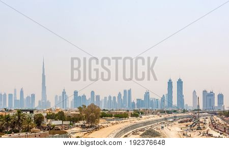 Hazy City Skyline Dominated by Super Skyscraper Burj Khalifa on Sunny Day in Dubai, United Arab Emirates