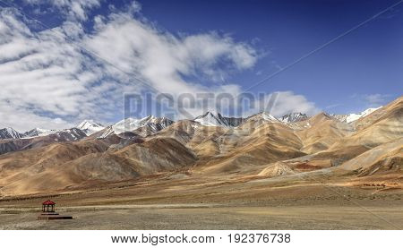 Himalayan mountains by Pangong Tso lake in Ladakh province of Kashmir, India