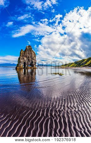 Scala Hvitsercur on the sea beach in the form of a huge mammoth. Ocean outflow at sunset. Northern coast of Iceland. Concept of extreme northern tourism