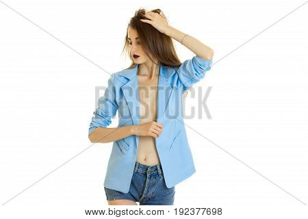 Young beautiful girl in blue jacket without bra under it look away isolated on white background