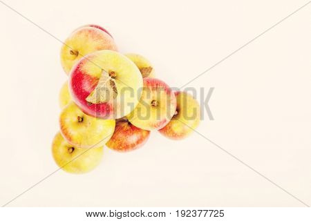 High angle view of apples forming pyramid over white background