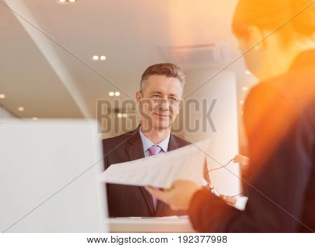Business people working in office cafeteria