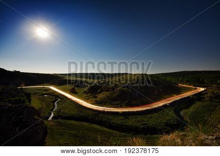 Landscape from Cheile Dobrogei, Romania in the summer evening with winding road in the distance