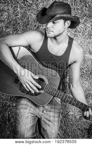 Cowboy playing country music guitar
