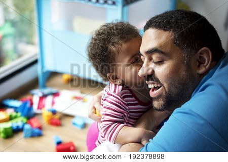Father lets daughter playing toy block for child development