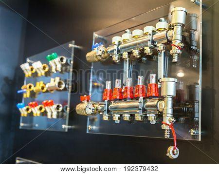 Floor heating collectors and valves, plumbing shop