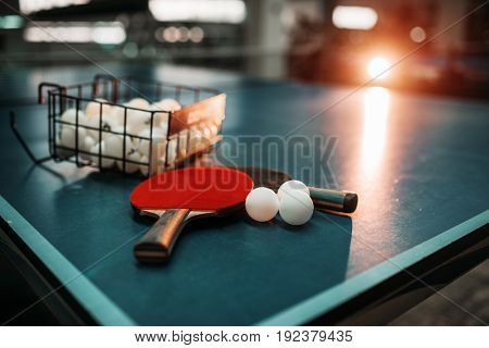 Ping pong table, rackets and balls in a sport hall