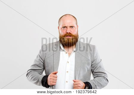 Embarrassed man in gray jacket