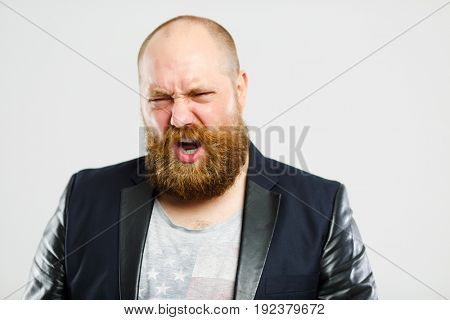 Dissatisfied brutal man with beard