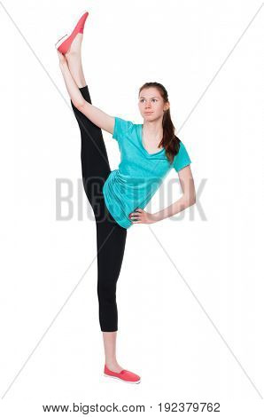 back view of standing young beautiful  woman in sportswear involved in Pilates. Rear view people collection. Isolated over white background. A girl stands with his legs above his head.
