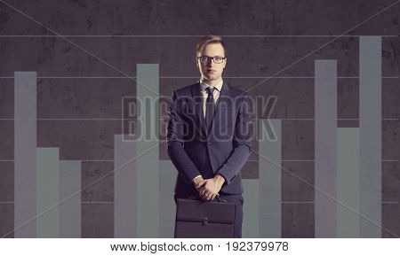 Businessman with briefcase standing on a column diagram background. Business, office, career, job concept.