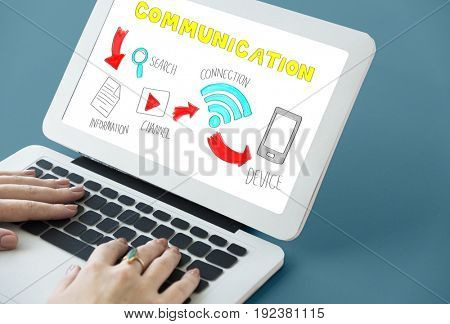 Hands working on laptop network graphic overlay