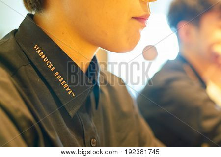 SEOUL, SOUTH KOREA - CIRCA MAY, 2017: close up shot of Starbucks Reserve sign on black shirt. Starbucks Corporation is an American coffee company and coffeehouse chain.