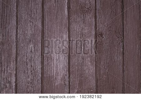 Vintage texture of painted brown old wooden gate with a metal jumper