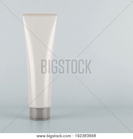 White tube. Product mock up on grey background. Blank packaging for cosmetic products like cream or lotion as well as tooth paste hair gel acrylic paint sauce and more.