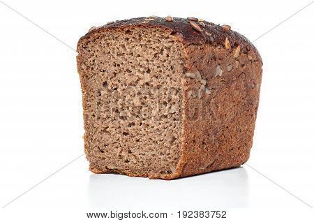 Rye and wheat bread with sunflower seeds on white background. Closeup sliced view