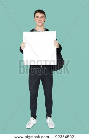 Young adult man holding blank banner